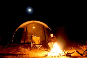 By moonlight and camp fire