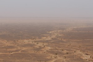 Desert as far as you can see through the dust clouds