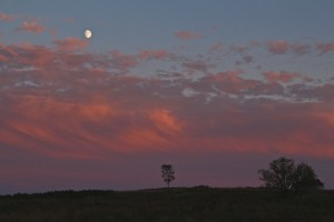 Fire and ice in the sky as the sun sets and the moon rises over the Kyles of Bute