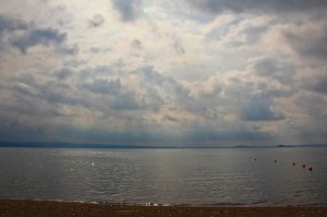 The light and clouds shimmer and shade across Lake Bolsena