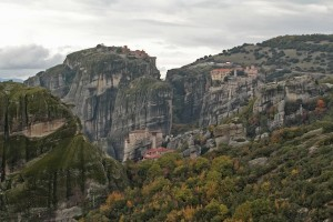 Almost impossible to see amongst the trees and rocks, a cluster of monasteries in Meteora
