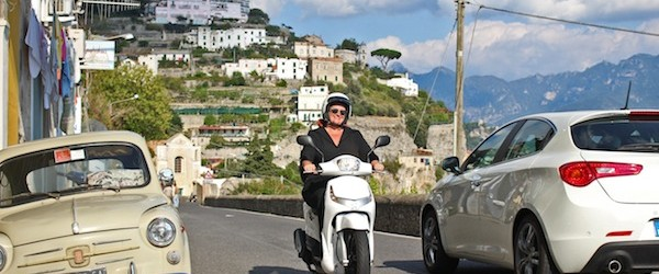Scooter vs. car on the Amalfi coast road