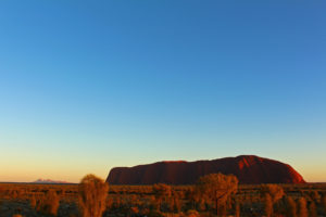 Sunrise over the rock, with the Olgas in the distance