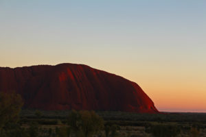 The first morning blush in the sky and on the end of Uluru